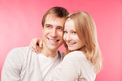Smiling couple hugging, looking aside Royalty Free Stock Photos