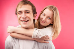 Smiling couple hugging, looking in the camera Stock Images