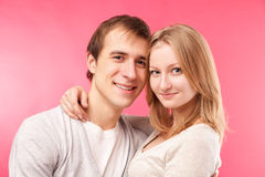 Smiling couple hugging, looking in the camera Royalty Free Stock Image