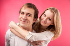 Smiling couple hugging, looking in the camera Stock Photo
