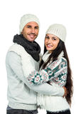 Smiling couple hugging and looking at camera Stock Photography