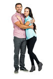 Smiling couple hugging and looking at camera. On white screen Royalty Free Stock Photo