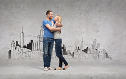 Smiling couple hugging and looking at each other Royalty Free Stock Images