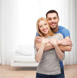 Smiling couple hugging Stock Photos