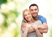 Smiling couple hugging Stock Images