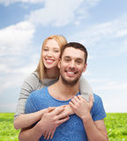 Smiling couple hugging Stock Photography