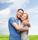 Smiling couple hugging Stock Image