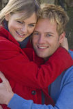 Smiling couple hugging outdoors Royalty Free Stock Photography