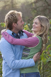 Smiling couple hugging outdoors Royalty Free Stock Photo
