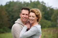 Smiling couple hugging outdoors Royalty Free Stock Image
