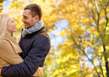 Smiling couple hugging over autumn background Royalty Free Stock Images