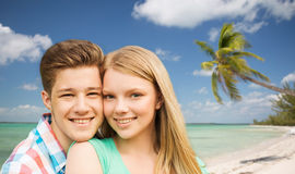 Smiling couple hugging over beach background Royalty Free Stock Photos