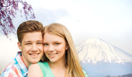Smiling couple hugging over fuji mountain in japan Stock Images