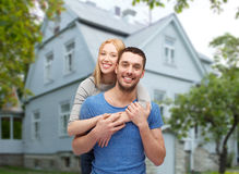 Smiling couple hugging over house background Royalty Free Stock Photo