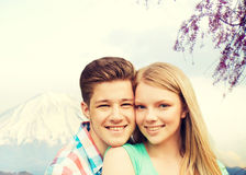Smiling couple hugging over mountains background Royalty Free Stock Photo