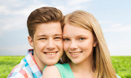 Smiling couple hugging over natural background Royalty Free Stock Image