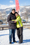 Smiling couple hugging on winter resort at Austrian Alps Stock Photo