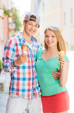 Smiling couple with ice-cream in city Stock Photography