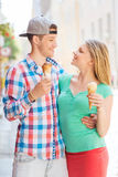 Smiling couple with ice-cream in city Stock Photos