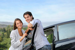 Smiling couple on a journey. Young couple on a week-end trip in car Royalty Free Stock Photo