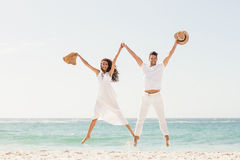Smiling couple jumping together Stock Images