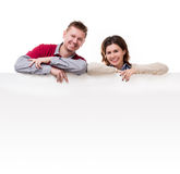 Smiling couple lean on empty blanket for ad Stock Image