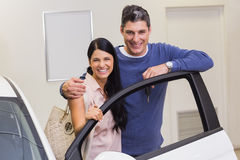 Smiling couple leaning on car Stock Photography
