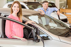 Smiling couple leaning on car Stock Photo