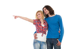 Smiling couple looking away and pointing Royalty Free Stock Images