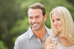 Smiling couple looking away Stock Photos