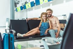Couple waiting for boarding at airport Stock Photo