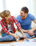 Smiling couple looking at color samples at home Royalty Free Stock Images