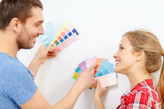 Smiling couple looking at color samples at home Royalty Free Stock Photography