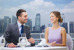 Smiling couple looking at each other in restaurant Royalty Free Stock Image