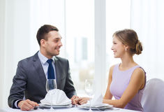 Smiling couple looking at each other at restaurant Stock Photos