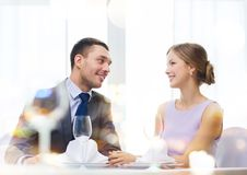 Smiling couple looking at each other at restaurant Royalty Free Stock Photos