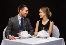 Smiling couple looking at each other at restaurant Royalty Free Stock Image