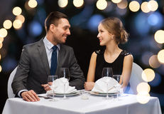 Smiling couple looking at each other at restaurant Stock Photography