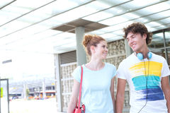 Smiling couple looking at each other while walking in city Stock Image