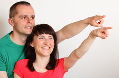 Smiling couple looking and pointing into distance Stock Photography