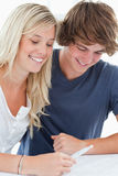 Smiling couple looking at the result of a pregnancy test Stock Photo