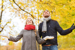 Smiling couple looking up in autumn park Stock Image