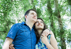Smiling couple looking up Stock Photography