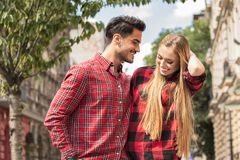 Smiling beautiful couple dating outdoors. Smiling couple in love dating outdoors.Young happy couple hugging on the city street royalty free stock photography