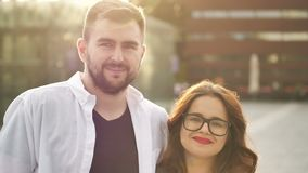 Smiling couple in love outdoors. Young happy couple hugging on the city street. Smiling couple in love outdoors.Young happy couple hugging on the city street 4K stock video footage