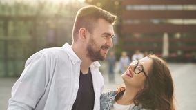 Smiling couple in love outdoors. Young happy couple hugging on the city street. Smiling couple in love outdoors.Young happy couple hugging on the city street 4K stock footage