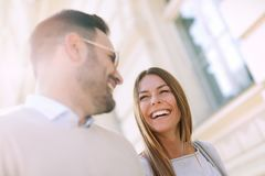 Smiling couple in love outdoors. Young happy couple walking on the city street stock photos