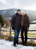 Smiling couple in love posing against Austrian Alps covered in s Stock Image