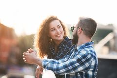 Smiling couple in love, walking and talking outdoors. In city royalty free stock photography