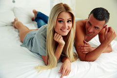 Smiling couple lying on bed Royalty Free Stock Photo